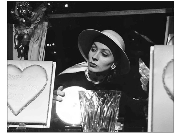 Suzy Parker in the chocolate maker window